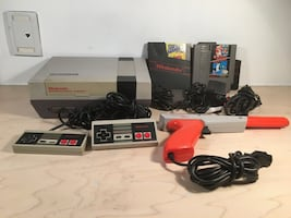 Vintage Nintendo NES with 2 controllers, gun and 3 games