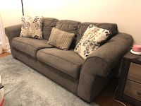 Large loveseat sofa very comfortable and includes decorative cushions  Gaithersburg, 20879