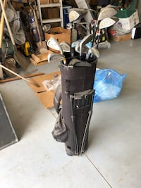 Black golf bag with golf clubs Howell, 48855
