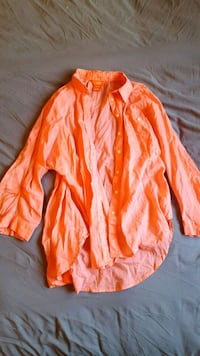 orange and white zip-up jacket Canmore