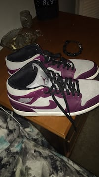 Pair of purple-and-white nike basketball shoes Charlotte