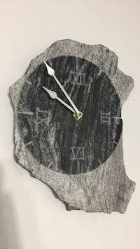 "Solid granite wall clock 12"" by 9"""