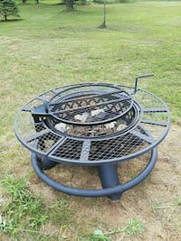 round black metal fire pit with grilling grate  Adams, 53910