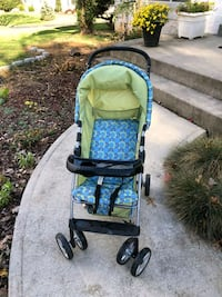 baby's green and black stroller 33 km