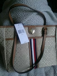 New Tommy Hilfiger purse. Retails for 98. Tags attached