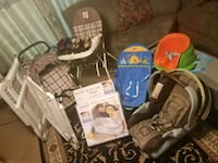 baby's brown and black car seat carrier