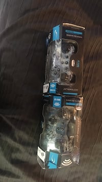 Both controllers are new box is kind of ripped up on right one. Both Wii U controllers 500 mi