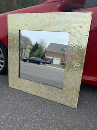 Gold  modern design mirror. Very neat and modern, It has been stored since purchased.  Alexandria, 22310