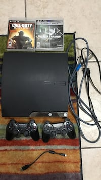 black Sony PS3 slim console with controllers McAllen, 78504