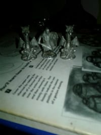 2 pewter dragons and 1 pewter knight 533 mi