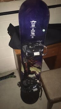 black and purple snowboard with bindings Burlington, L7T