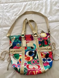red, green, and white Coach 2-way handbag