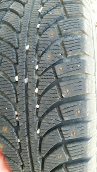 3 studded tires and rims off Honda Ridge line.  Calgary, T2S 2X4