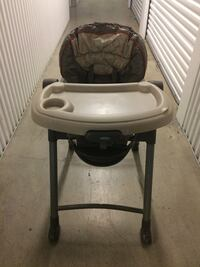 baby's gray and black high chair