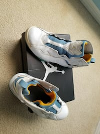 white-and-blue Air Jordan shoes with box