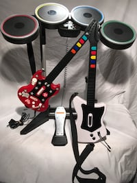 Black electric drum set and two guitar controllers