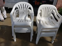 9 white plastic  chairs Tucker, 30084