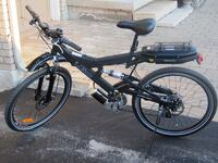 Black and gray full suspension electric mountain bike lithium battery Toronto, M2L 2W7