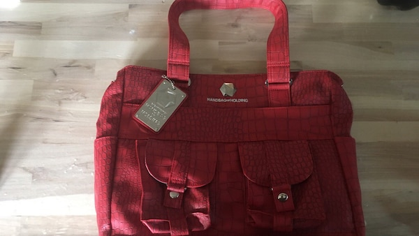 9326b66bb78d Used Red dragonscale handbag of holding from thinkgeek for sale in  Manchester - letgo