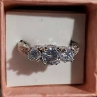 silver-colored clear gemstone encrusted ring with box