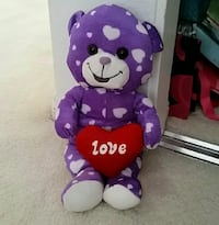 purple and white bear plush toy