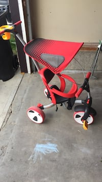 toddler's red and black canopy push trike Calgary, T3K 0A4