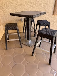 DESIGNER SAMPLE SALE #00- Outdoor high top dining table and 4 bar stools  - sold as a set only . great conditions  Las Vegas