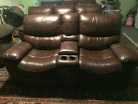 Reclining leather sofa and love seat Metairie