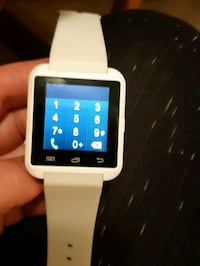 white smartwatch with white strap Vancouver, V5M 1P3