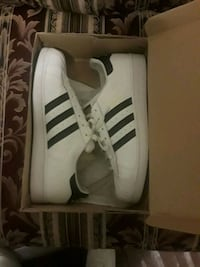 pair of white adidas low-top sneakers with box 1102 mi