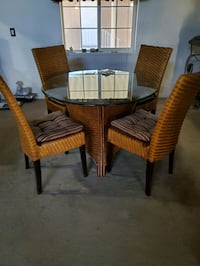 Wicker table glass top and 4 chairs