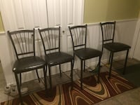 four black metal framed brown leather padded chairs Airdrie, T4A 1G2