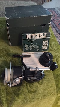 mitchell garcia spinning reel (vintage) in box with instruction booklet ( made in france)  with spate part Boise, 83716
