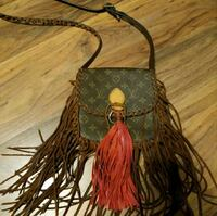 Authentic Fringe Louis Vuitton purse 1200 mi