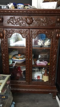 Brown wooden framed glass display cabinet Surrey, V3R 3P3