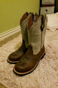 pair of brown leather cowboy boots Leander, 78641