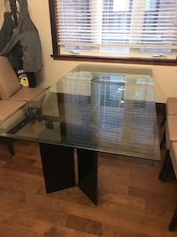 rectangular black wooden table with chairs Toronto, M6E 3H5