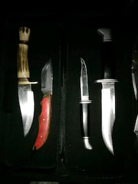 four gray stainless steel bowie knives