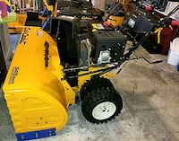 yellow and black snow blower 41 km