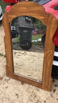 Arch-shaped brown wooden frame mirror