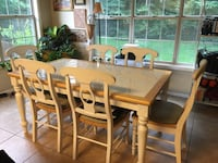 White tile top tank with 7 chairs; good condition