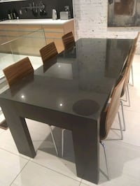 rectangular black wooden table with six chairs din Montréal, H1N 2T2