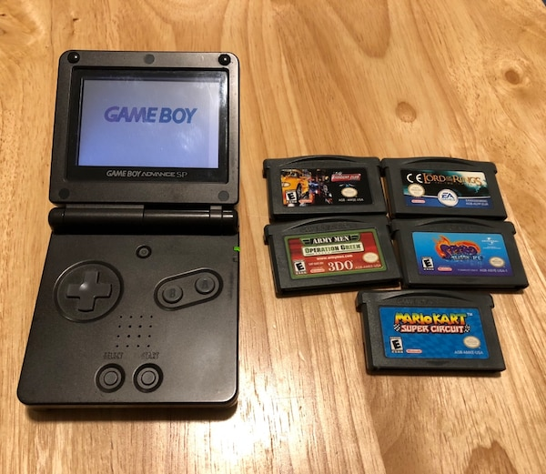 used black nintendo game boy advance sp with game cartridges no