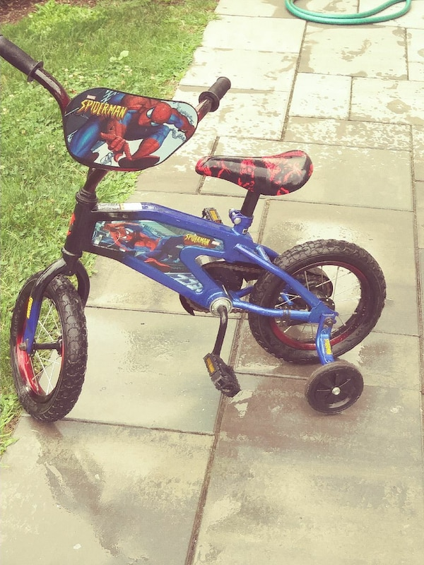 children's blue and red Spider-man bicycle with training wheels