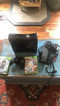 black Xbox 360 console with controller and game cases Martinsburg, 25404