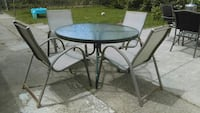 round brown wooden table with four chairs patio set Hamilton, L8H 2R1