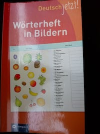 German learning book with drawings