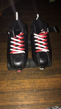 Pair of black-and-red zoom skates  Indianapolis, 46203