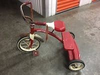 toddler's red and white Radio Flyer trike 229 mi