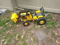 yellow and black Caterpeg front loader ride-on toy